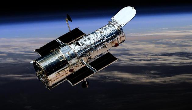 Photo of Лучи в черную дыру: Hubble показал необычные тени в центре галактики